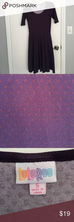 Plum purple diamond print Lularoe Nicole dress Very gently worn from a smoke and pet-free home. This is a deep plum purple with very subtle/dark, small diamond print in maroon. The neckline shows the white backing fabric just slightly. LuLaRoe Dresses