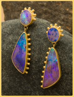 Absolutely phenomenal boulder opals are set in a one of a kind design of 18kt gold by Norah Pierson. Unbelievable color, fire and lustre in these stones!
