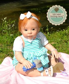 "HADLEY is a custom order baby. I created her from Donna RuBert's ""Annie"" sculpt. She was born April 27, 2014, is 26"" long, weighs 13 lbs. 8 oz. and lives in ALABAMA, USA. See her at www.heartstringsnursery.com."