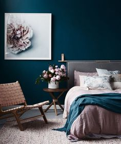 Dark blue walls in pink bedroom