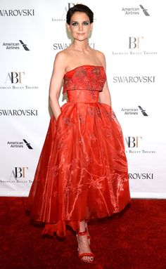 Katie Holmes wears a tea-length red strapless Zac Posen dress at the American Ballet Theatre Spring Gala.