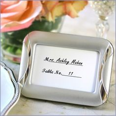 Distinctively modern, our alluring Brushed Finish Photo Frame/Place Card Holder accentuates your #wedding decorations with #sophisticated style. These enchanting silver place card holders set the scene for a #romantic evening, showing your guests to their seats with sophistication Retail: $1.46