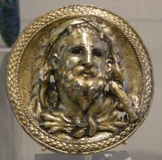 Silver-gilt roundel bearing a bust of Heracles. Artist unknown; Hellenistic period. Now in the Metropolitan Museum of Art. Photo credit: Sailko/Wikimedia Commons.