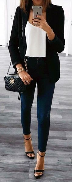 #winter #outfits  black blazer with white tank top and blue slim-fitted jeans outfit