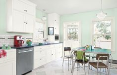 Palest mint gives this kitchen a cool and bright vibe. The green tint echoes the stained glass in the back door. Mint Kitchen Walls, Mint Green Kitchen, Mint Green Walls, White Kitchen Cabinets, Kitchen Redo, New Kitchen, Kitchen Remodel, Kitchen Dining, Kitchen Ideas