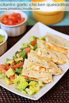 Cilantro garlic chicken quesadillas -- so good and so easy! Must make these for our next Taco Tuesday. #quesadilla #mexican #mexicanfood via isthisreallymylife.com