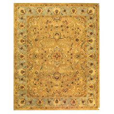 Hand-tufted wool rug with a Persian-inspired motif.   Product: RugConstruction Material: 100% WoolCol...