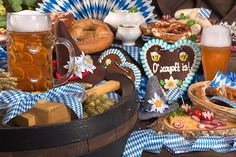 Decorating for Oktoberfest is simple and casual. Cover long tables in traditional blue and white checkered tablecloths and prop silverware and napkins in wooden crates or straw baskets. Fill ceramic vases or glass beer pitchers with simple arrangements of daisies, sunflowers, or stalks of wheat. Hang some Bavarian flags and banners on the wall. Find everything you need to plan your own Oktoberfest party at http://sparklerparties.com/blog/oktoberfest-party-fun/