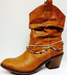 Boot chain made of Silver tone chain with second chain of brown barrel and turquoise colored beads. Lobster clasp