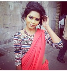 """Looking to make a statement at your next party?  Try mixing a modern """"crop top"""" with a bold coloured sari!  I like the simple red bindi as a traditional element ::"""