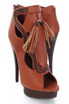 Stylish bootie heels featuirng faux leather, color block, cutout design, shield front, removable tassel, back heel zipper closure peep toes. Insole with faux leather lining, lightly cushion foot-bed, out-sole with rubber traction. Approx 5  inch heels 1 inch platform.