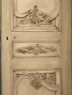 Antique French Set of Eight Carved Doors in Old Paint | From a unique collection of antique and modern doors and gates at https://www.1stdibs.com/furniture/building-garden/doors-gates/