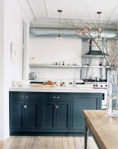 Jenna Lyons Black and White and Wood Kitchen - exhaust visible