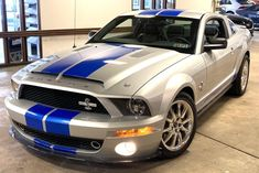 """This 2009 Ford Mustang Shelby GT500KR is #170 of 712 examples produced for the model year, and it was acquired by the selling dealer from the family of the original owner. The car is finished in Brilliant Silver Metallic with Vista Blue stripes over black leather and powered by a supercharged 5.4-liter DOHC V8 paired with a Tremec six-speed manual transmission and a limited-slip differential. """"King of the Road"""" examples left the Ford assembly line as standard GT500s and were upgraded by the… 2009 Ford Mustang, Ford Mustang Shelby, Ford Mustangs, Black Mustang, Goodyear Eagle, Pontiac Catalina, Tribute, Limited Slip Differential, Aluminum Wheels"""