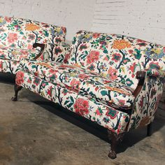 Warehouse 414 - Beautiful, bold and bright!  This pair of antique floral loveseats with their elegant Chippendale style ball and claw feet are just what the doctor (or designer) ordered to brighten your living room.  A great English club style pair of loveseats sporting a tight back and single bench-style seat cushion.  #furniture #chippendale #loveseats #sofas #livingroom #vintage