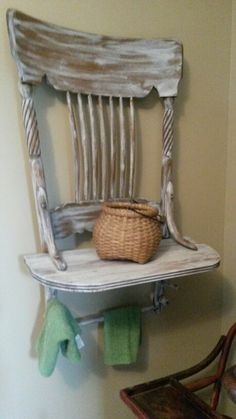 Repurposed old chair into shelf with towel holders for bathroom