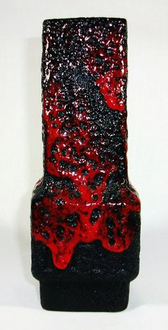 http://www.ebay.co.uk/itm/Jopeko-Mid-Century-Fat-Lava-West-German-Pottery-Ceramic-Vase-19-5cm-/221720512085?pt=LH_DefaultDomain_3
