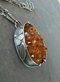 This beautiful necklace is handmade by me using sterling silver and a golden citrine natural druzy. The pendant hangs on a handmade chain with hook clasp made by me. The necklace measures approximately 21 inches in length and can be worn at shorter lengths by hooking clasp on any link. It