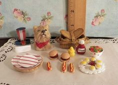 Patirotic miniature yorkie with picnic basket  and hot dogs  ect.