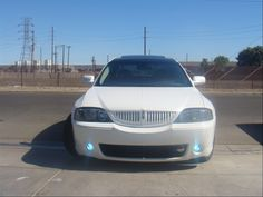 2004 4door Lincoln LS Sedan pearl white custom paint job w/ custom fog lights. ii so want this car!!