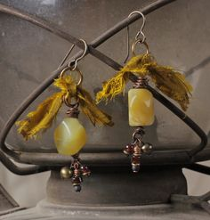 Saffron earrings: african yellow opal, garnet, recycled sari silk ribbon. $23.00, via Etsy.