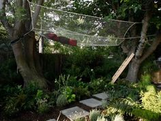 Landscape designer Jamie Durie created the perfect spot for lazy outdoor lounging with this mesh hammock. Hanging high between two trees, the hammock can only be accessed by a wooden ladder.