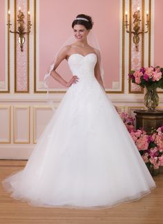 Sweetheart Gowns sweetheart style 6035 Alencon and corded soutache lace ball gown features sweetheart neckline  and asymmetrically draped tulle over lace with a natural waistline.   Style is finished with chapel length train and satin buttons over  zipper.