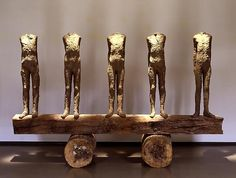 Magdalena Abakanowics Five Small Figures on a Beam, 1992  Burlap, resin and wood  76 3/8 x 100 x 29 1/2 in.  194 x 254 x 74.9 cm