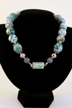 Anything blue does it for me!  Agate and Sterling Silver with a Peruvian Opal clasp.  Price: $188.00