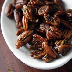 Recipe Spiced Pecans-These fragrant, skillet-roasted pecans get their earthy, spicy bite from rosemary, Spanish smoked paprika, and chili powder. Spiced Pecans, Roasted Pecans, Candied Pecans, Almonds, Appetizer Recipes, Snack Recipes, Cooking Recipes, Delicious Appetizers, Holiday Appetizers