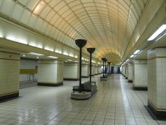 Gants Hill London Underground station.  The circulation hall between the platforms at this Central Line station designed by Charles Holden. The cream titling design at Gants Hills is the same as those found at the other stations on this tunnelled section of the Hainault branch of the Central Line. This tiling was applied during the New Works Programme between 1935-1940. It can also be seen at the Northern Line station Highgate, as well as Bethnal Green on the Central Line.