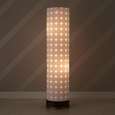Dotted Glow Floor Lamp - its tall, double lined shade lets the subtle dotted pattern stand out while giving off a brilliant glow.
