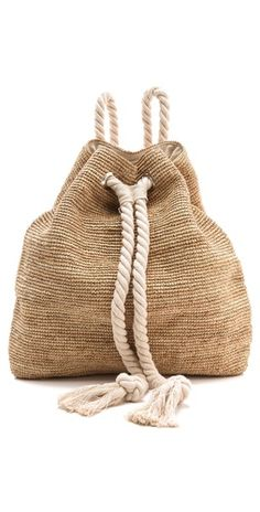For a casual outfit, keep it simple & look for natural fibers. Bop Basics Raffia Crochet Backpack