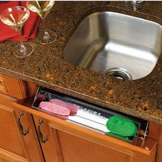 "Kitchen and Vanity Sink Front (Tip-Out) Stainless Steel Trays by Rev-A-Shelf | KitchenSource.com  Rev-A-Shelf 6581 Sink Front - 11"" Standard Tray.  These are awesome, and turn that unused sealed panel in front of your sink into flip open sponge/glove storage."