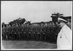 Goering standing with Luftwaffe personnel at Amsterdam Schiphol