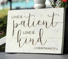 A beautiful slatted wood hand painted sign: Love is patient, Love is kind. 1…