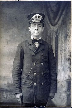 young man in train conductor uniform 1920's