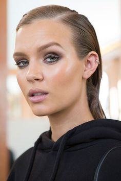 Break out your blush and throw away your beauty inhibitions. This season's backstage makeup trends were all about electric color and tactile textures worn with fierce confidence.