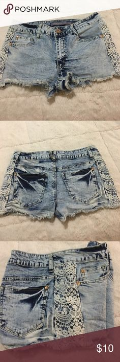 """Frayed denim blue jean shorts Adorable blue jean shorts with lace like side detail approximate length 10"""" great with a pair of white keds. 98% Cotton 2% spandex Boom Boom Jeans Shorts Jean Shorts"""