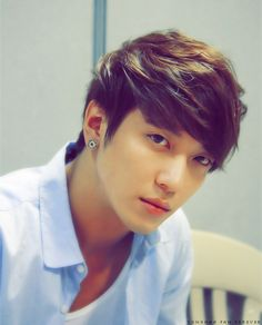 Yonghwa of CN Blue (씨엔블루) the hair was nicely stacked on eachother and pushed to the left with some waves to add style