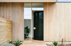 Front Door Design Idea - Use An Oversized Circular Door Handle For A Unique Look