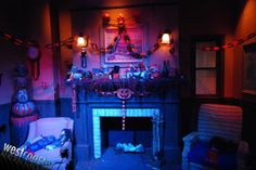 "HHN 2010, Universal Studios Hollywood    Halloween decorations drape the living room of the Firefly family, in Halloween Horror Nights Hollywood's ""House of 1000 Corpses: in 3D ZombieVision"" house.    Photo by Albert Lam & Dan Angona, courtesy Westcoaster.net."