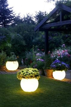 garden lighting ideas (altho purported to be simply painted w/glo in the dark paint, comments dispute this. I agree, that's a heck of a light spread on the grass)