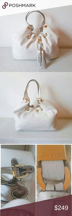 Michael Kors Large Bag Michael Kors Camden large shoulder bag in white with shiny gold hardware and trim. Beautiful tassles serve to accent this bag and give it style. This is a plush soft comfy leather bag great for summer! This bag is worn and loved and taken loving care of. It's in excellent condition with minor barely noticeable marks above the tassles, the underpart of the bottom of the handles near the bag opening and slight minor discoloration on the backside near the bottom as shown…