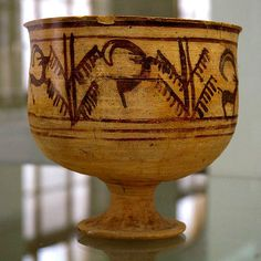 A 5,200-year-old bowl found in Iran's Burnt City, the so-called animation vase, as you turn it, a goat is seen in process of leaping to snatch leaves from a tree.