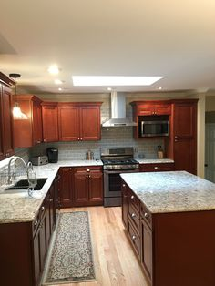 Kitchen remodel by Garrett H. of Rochester, NY. We used theYork Cherry Cabinets. Ordering and delivery time worked out great on a tight schedule. The kitchen looks amazing!
