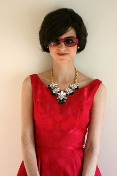 Esquire of Style at esqstyle.com ; Jackie O.; Jackie Kennedy; Vintage; petite; short hair; bob; growing out a pixie; statement necklace; pink; chanel sunglasses