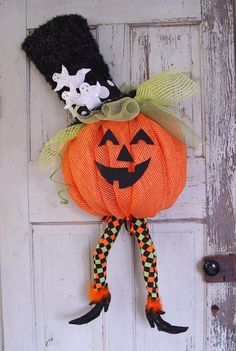 Deco Mesh Pumpkin with Witch Legs - Video and Written Tutorial at Trendy Tree! #TrendyTree