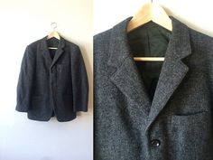 This handsome 1960s hand woven Harris Tweed blazer features a beautiful heavyweight thornproof weave charcoal grey fabric. This three button