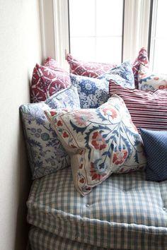 Throw pillows in pretty fabrics - Sara Gilbane